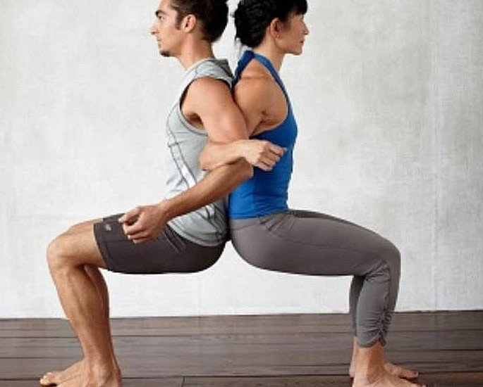 Great Yoga Positions for a Better Sex Life - Back to Back Chair Pose