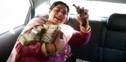 Indian Aunty shows off Lots of Cash and Jewellery with Gun
