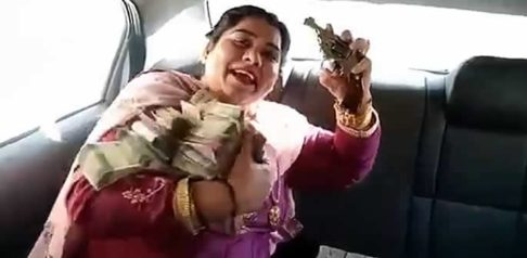 Indian Aunty shows off Lots of Cash and Jewellery with a Gun f