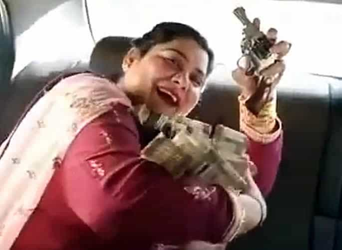 Indian Aunty shows off Lots of Cash and Jewellery with a Gun - flashes gun