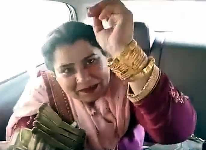 Indian Aunty shows off Lots of Cash and Jewellery with a Gun - gold bangles