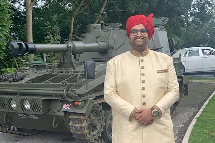 Big John's Groom arrives at Wedding in a Tank - Groom