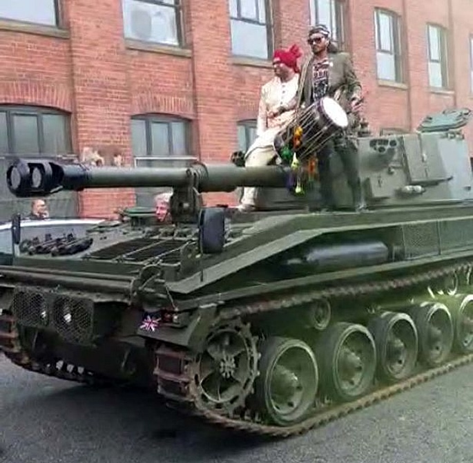 Big John's Groom arrives at Wedding in a Tank - arrival