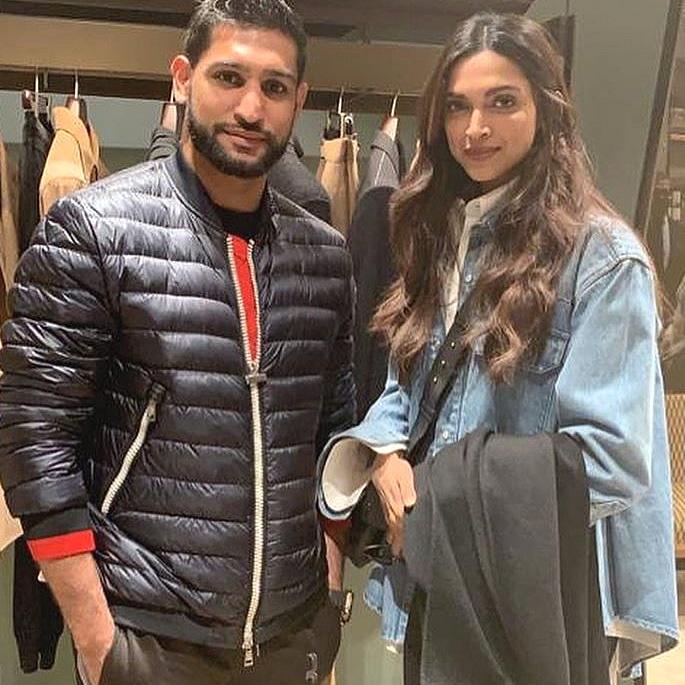 Deepika and Ranveer pose with Boxer Amir Khan in London 2