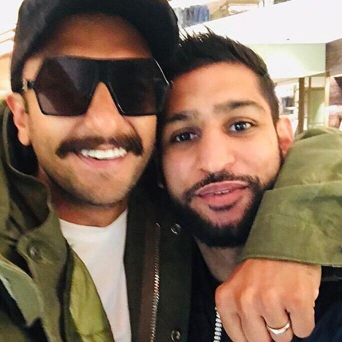 Deepika and Ranveer pose with Boxer Amir Khan in London