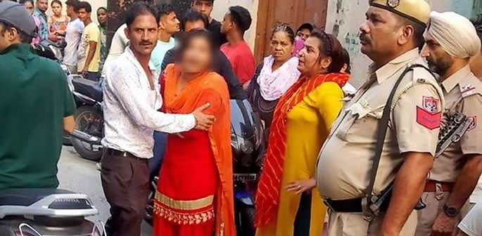 Indian In-Laws beat Daughter-in-Law on Road with Sticks f