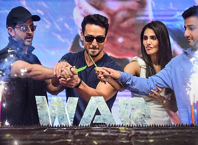 Hrithik & Tiger's WAR rages on passing Rs 100 Crores - cake