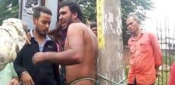 இந்தியன் மேன் ஒரு துருவத்துடன் பிணைக்கப்பட்டு, ஆபாசமான சட்டத்திற்காக அடிக்கப்பட்டார்