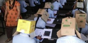 Indian Students made to wear Boxes on Heads for Exams f