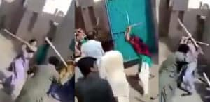 Violent Stick Fight erupts with Women and Men in Pakistan