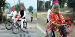 ભારતીય પુરૂષ તેની સાયકલ પર બ્રાઇડ હોમ લઈ જાય છે