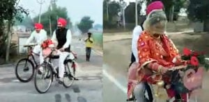 Indian Groom Picks Up His Bride on his Bicycle