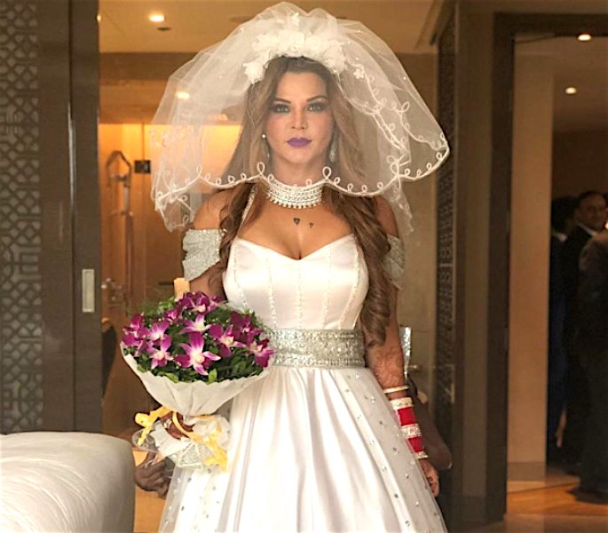 Rakhi Sawant says Husband was a 'Virgin' when They Married - white dress