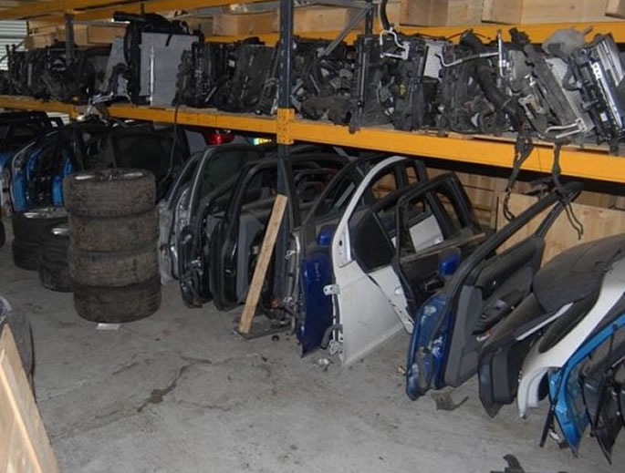 One of UK's Largest 'Chop Shop' Gangs busted by Police - car parts