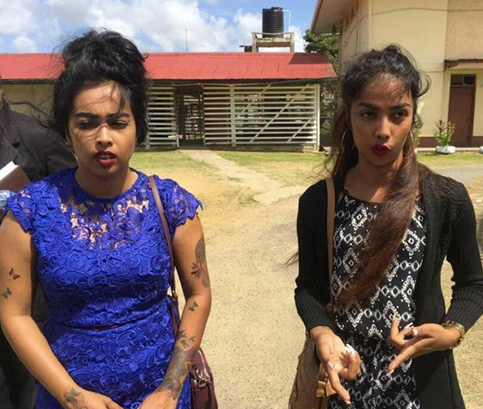 Two Guyanese Indian Sisters charged with Assaulting Cops - outside court