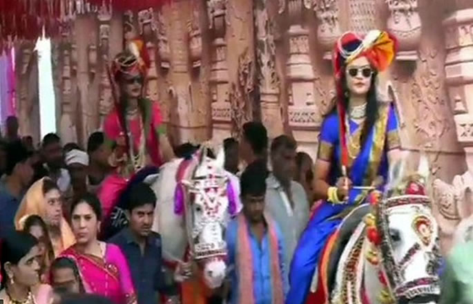 Indian Sisters arrive at Wedding On Horses with Swords - sis