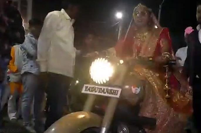 Indian Bride arrives on a Bullet Motorbike & Surprises Groom - bike
