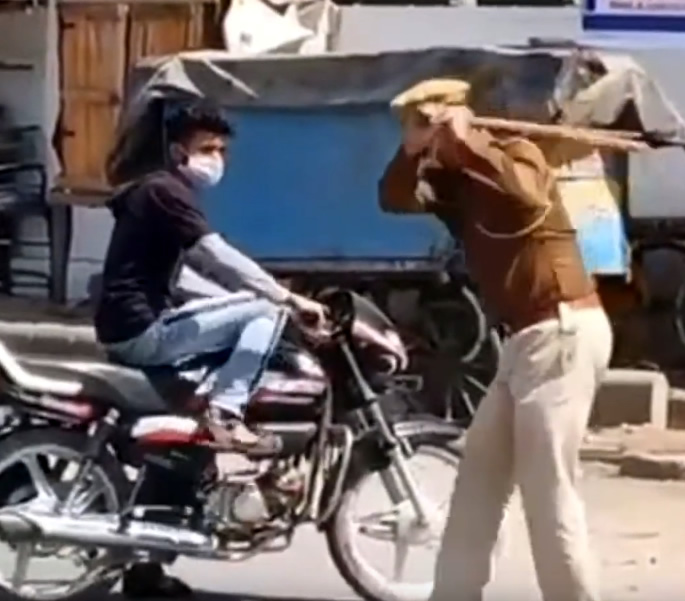 Indian Police beat Public with Lathis to enforce Janta Curfew - beating