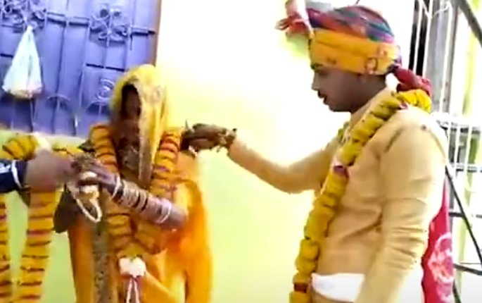 Indian Wedding takes Place without Pundit amid Curfew - garlands