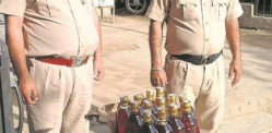 Indian Woman caught Selling Liquor from Home amid Virus