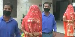 ભારતીય માણસ કરિયાણાની ખરીદી કરે છે અને સ્ત્રી સાથે પરત આવે છે