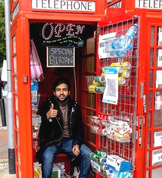 Man opens 'World's Smallest Takeaway' from red Phone Box