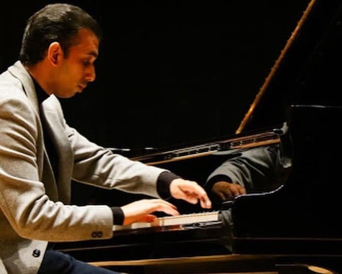 Pianist Rekesh Chauhan talks Music & Watch Party Series - playing piano