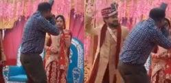 Lo sposo indiano colpisce il fotografo per essersi avvicinato troppo alla sposa
