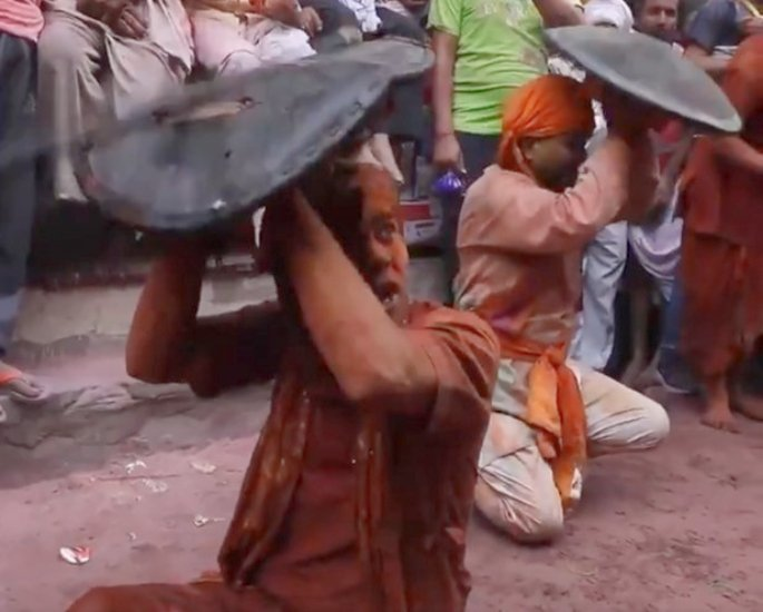 Indian Women beat Men with Sticks at Lathmar Holi -