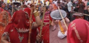 Indian Women beat Men with Sticks at Lathmar Holi f